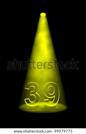 Number 39 illuminated with yellow spotlight on black background - stock photo