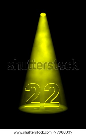 Number 22 illuminated with yellow spotlight on black background - stock photo