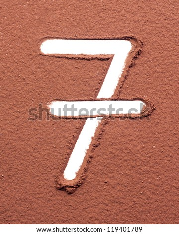 Number 7 made of cocoa powder on white background - stock photo
