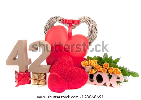 Number of age in a colorful studio setting with heart and gifts and yellow roses - stock photo