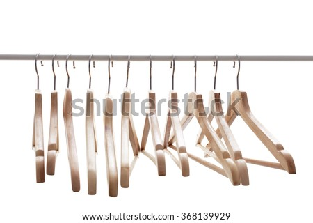 number of empty hangers after a major sell-off in the store. Wooden bright  hangers for coat and dress on the rack - stock photo