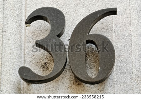 Number 36 on a wall - stock photo