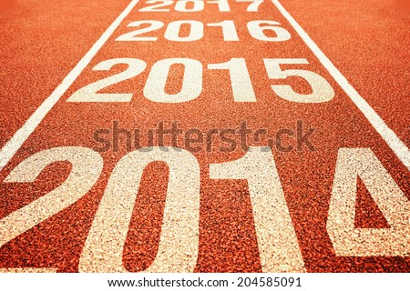 Number 2015 on athletics all weather running track withe preceeding and following years. Happy new 2015 year. Running fast towards New Year. - stock photo