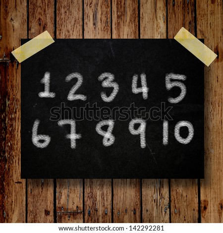 number on message note with wooden background - stock photo