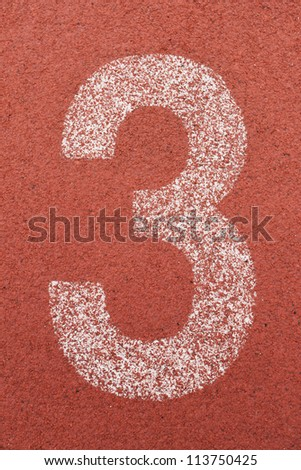 number 3 on running track - stock photo