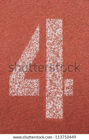 number 4 on running track - stock photo