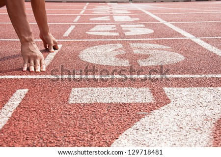 Number 6 on running track - stock photo