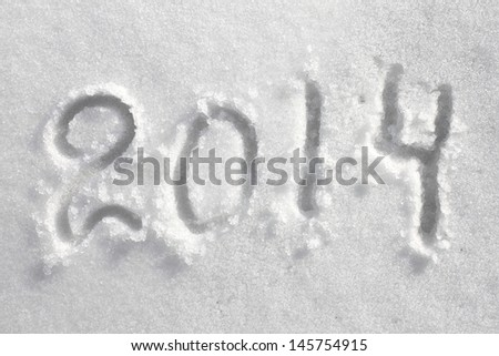 Number 2014 on snowdrift, New Year's background
