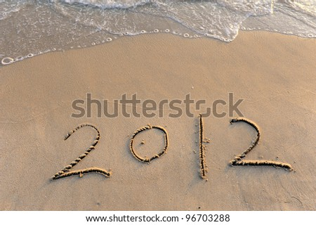 number 2012 on the beach of sunrise - stock photo