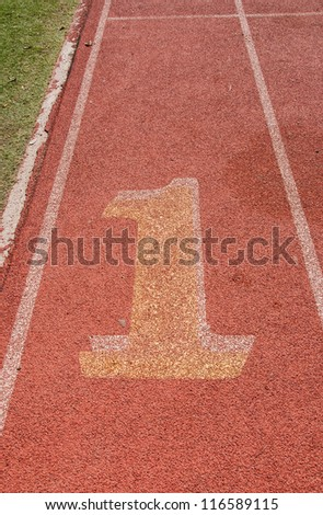 Number one lane on athletic track and field sports track.
