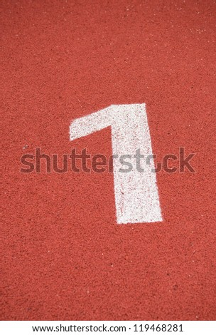 Number one on the start of a running track.