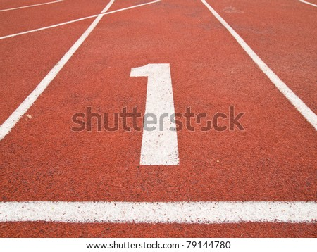 Number one on the start of a running track - stock photo