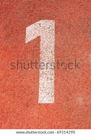 Number one on the start of a running track - check my portfolio for other numbers - stock photo
