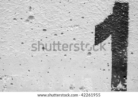 Number one stencil sprayed on rough concrete surface. Black and white. - stock photo