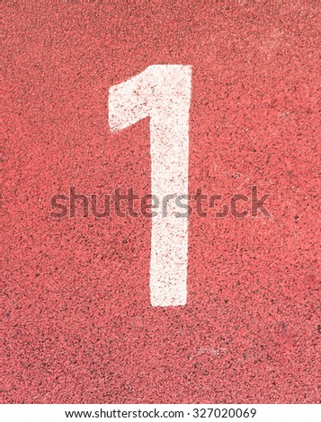 Number one,White track number on rubber racetrack, texture of running racetracks in small stadium. - stock photo