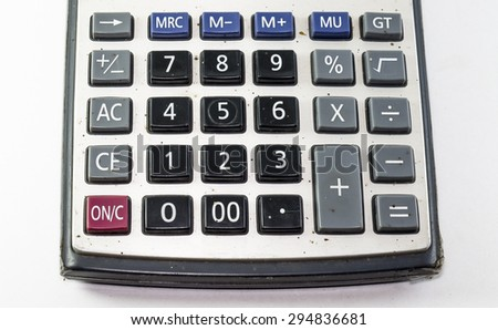 Number pad of old used calculator on white background