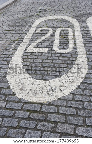 Number 20 painted on cobbled street in London; UK - stock photo
