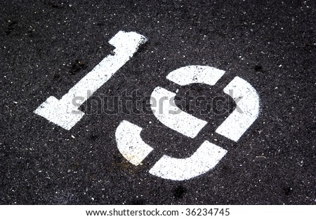 number 19 painted on pavement - stock photo
