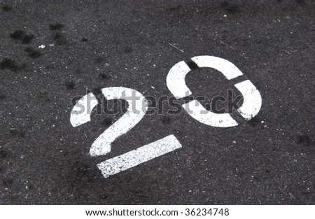 number 20 painted on pavement - stock photo