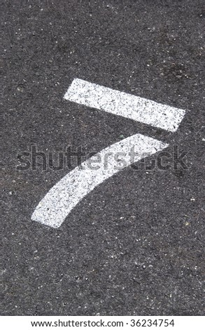 number 7 painted on pavement - stock photo