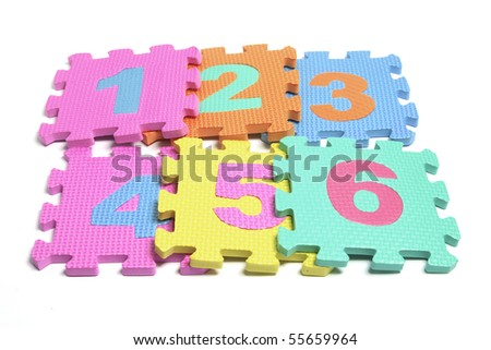 Number Puzzle Pieces on White Background