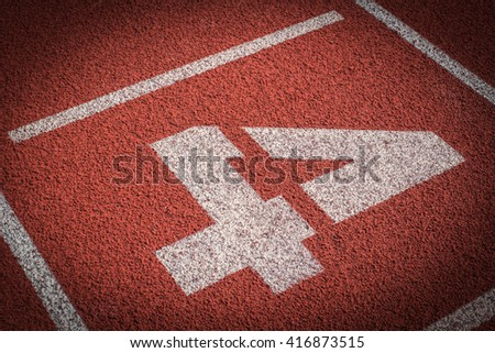 Number 4, Running track for the athletes background - stock photo