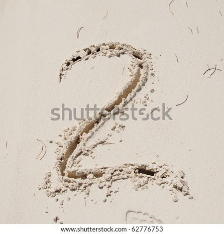 Number 2. Sand Alphabet: digits. Concept holiday background. - stock photo