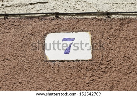 Number seven housing door sign, construction - stock photo