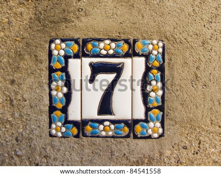 Number seven in a ceramic tile on street - stock photo