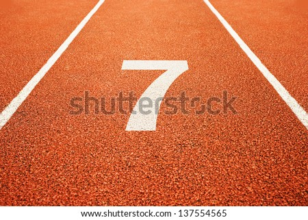 Number seven on athletics all weather running track - stock photo