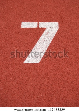 Number seven on the start of a running track.