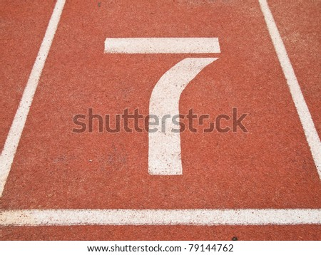 Number seven on the start of a running track
