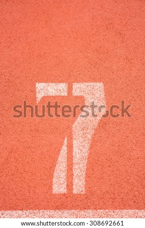 Number seven on the start of a running track - check my portfolio for other numbers