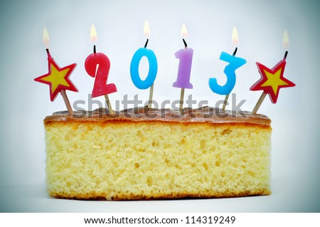 number-shaped candles of different colors forming number 2013 on a cake - stock photo