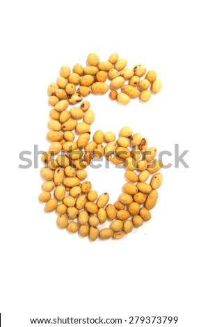 Number six made by sweets beans with colored sugar coat - stock photo