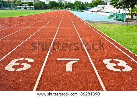Number six  seven and eight on the start of a running track