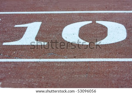 Number ten on running track. - stock photo