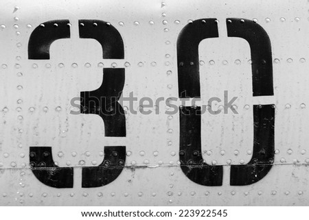 number thirty on the fuselage - stock photo