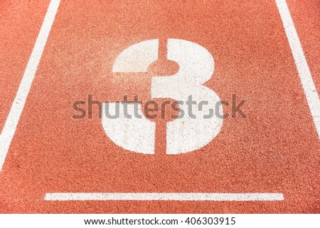Number three on running race lane