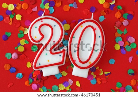 Number twenty birthday candle on red background