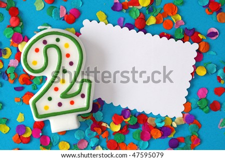 Number two birthday candle on blue background - stock photo