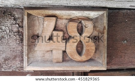 number 48 woodcarving - stock photo