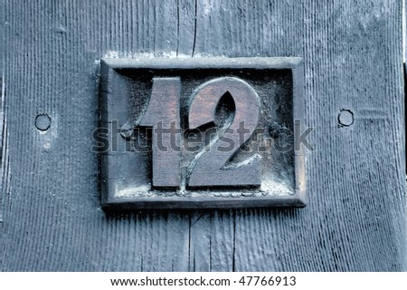 number '12' woodcarving