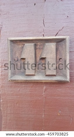 number 11 woodcarving form old town - vertical and isolated - stock photo