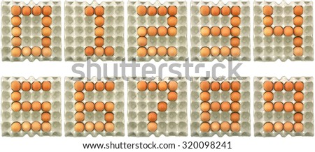 Number zero one two three four five six seven eight nine ten show by eggs in paper tray isolated on white background - stock photo