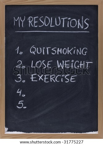 numbered resolution lists (quit smoking, exercise, loose weight, ...) - handwriting with white chalk on small blackboard, copy space - stock photo