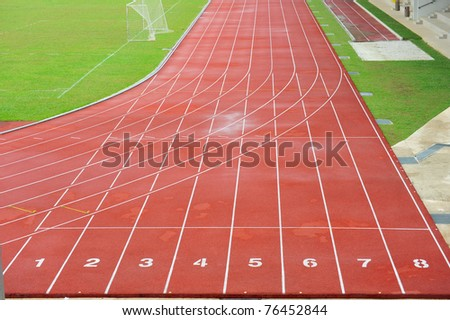 Numbered Running Track At  A Sport Stadium - stock photo