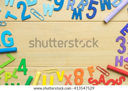 Numbers and English alphabets on wooden background ready for text - stock photo