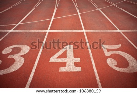 Numbers 3, 4 and 5 on running track. Perspective view. - stock photo