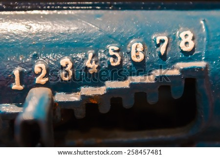 Numbers in vintage style, grunge, located as stairs on old blue metal background - stock photo